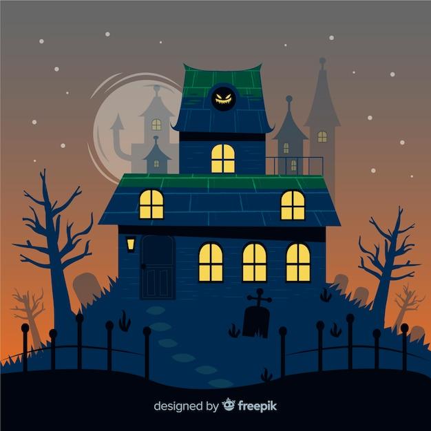 Mão desenhada casa de halloween com torres no fundo Vetor grátis