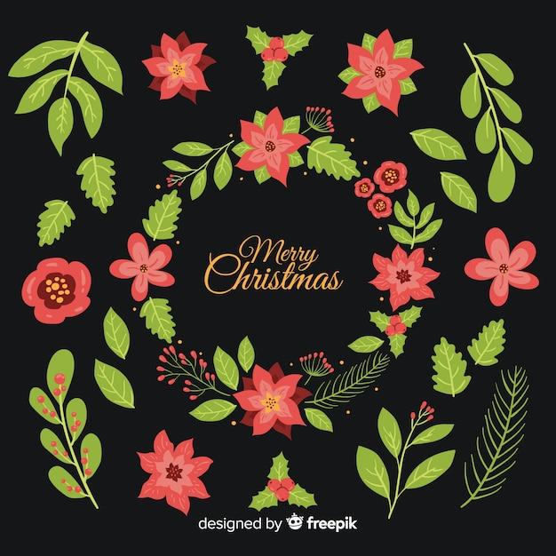 Mão desenhada coleção de flores de natal Vetor grátis