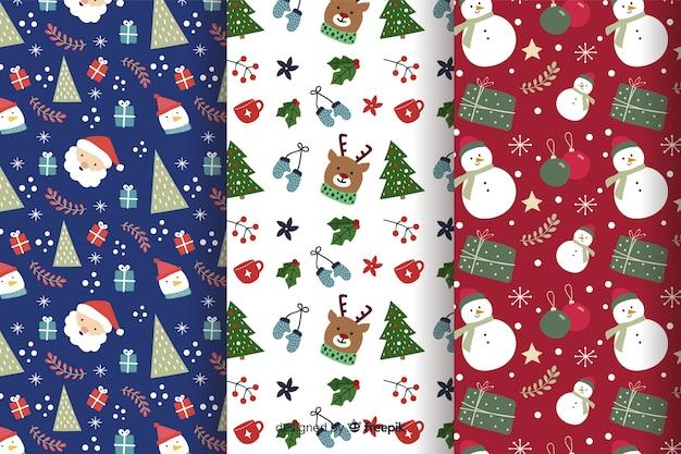 Mão desenhada coleção padrão de natal Vetor grátis