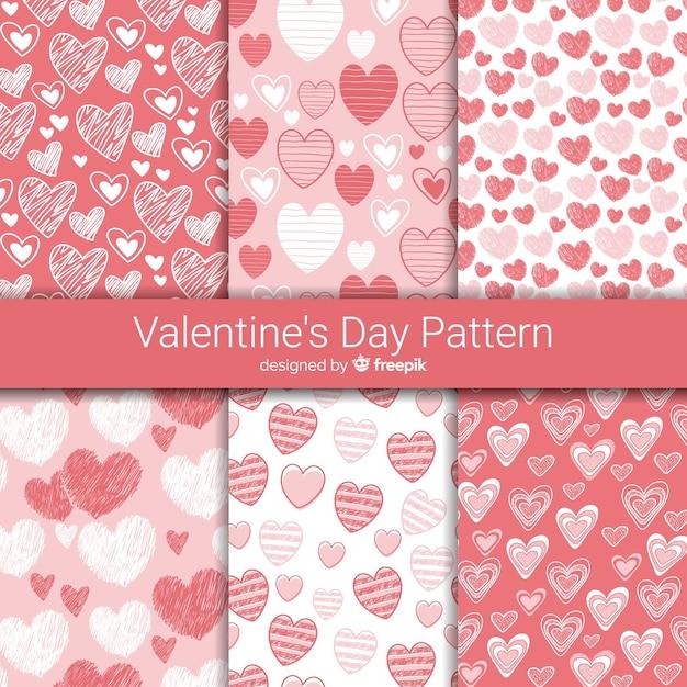 Mão desenhada corações coleção de padrão de dia dos namorados Vetor grátis
