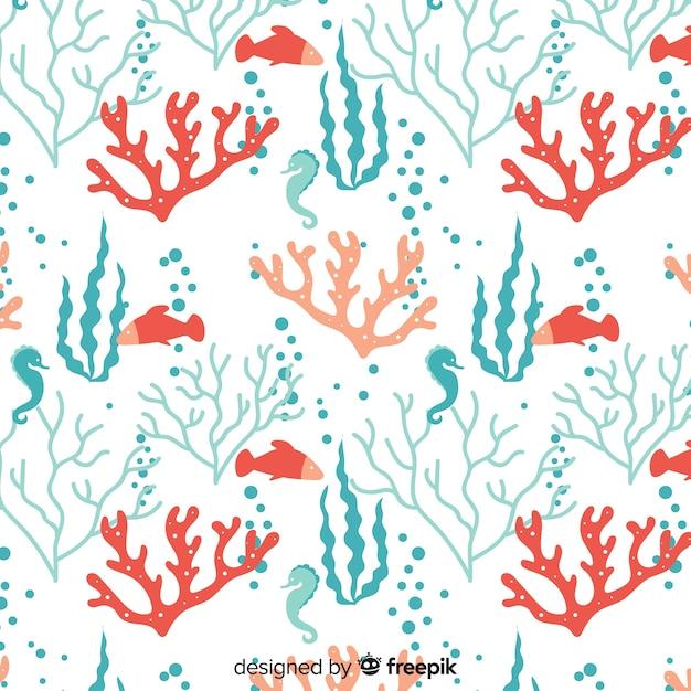 Mão desenhada coral com fundo de animais do mar Vetor grátis