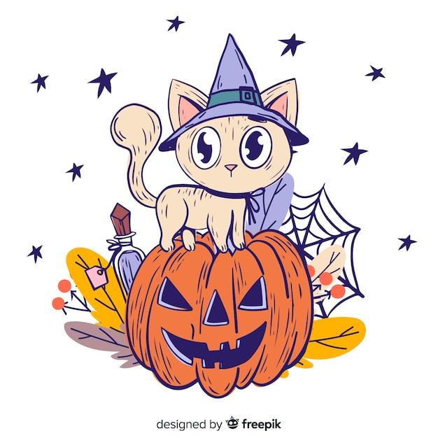 Mão desenhada de gato de halloween em uma abóbora Vetor grátis
