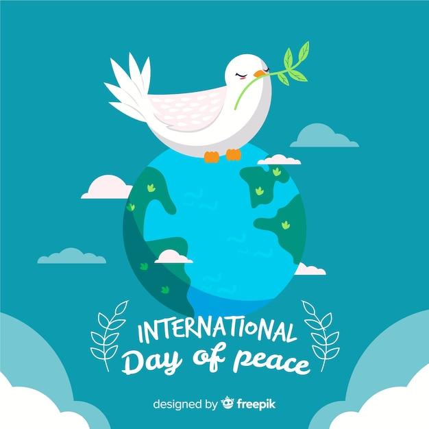 Mão desenhada dia da paz com pomba na terra Vetor grátis