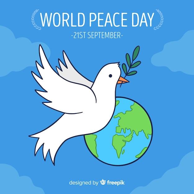 Mão desenhada dia da paz com uma pomba Vetor grátis