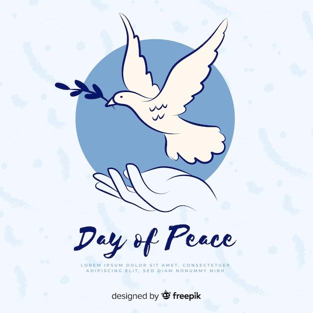 Mão desenhada dia da paz pomba Vetor grátis
