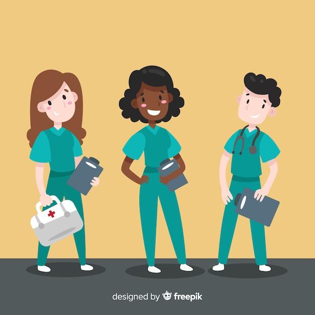 Mão desenhada enfermeira equipe Vetor grátis