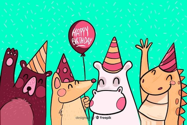 Mão desenhada feliz aniversário fundo com animais Vetor grátis
