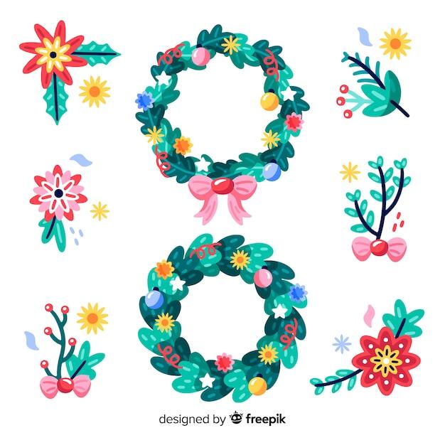 Mão desenhada flores e grinaldas de natal floral Vetor grátis