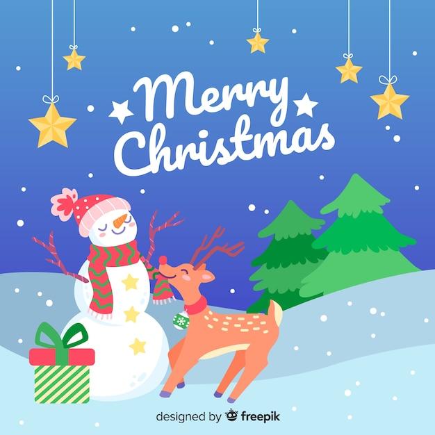 Mão desenhada fundo de natal com boneco de neve e renas Vetor grátis