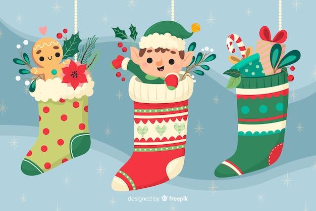 Mão desenhada fundo de natal com meias de natal Vetor grátis