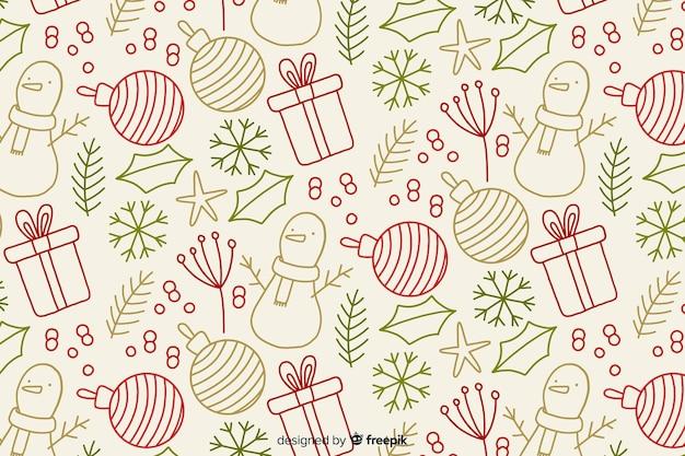 Mão desenhada fundo de natal Vetor grátis