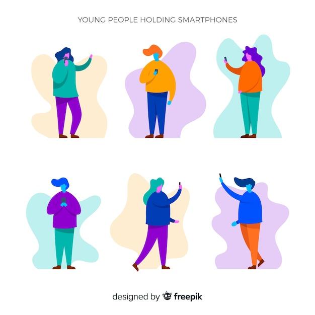 Mão desenhada jovens usando smartphone conjunto Vetor grátis