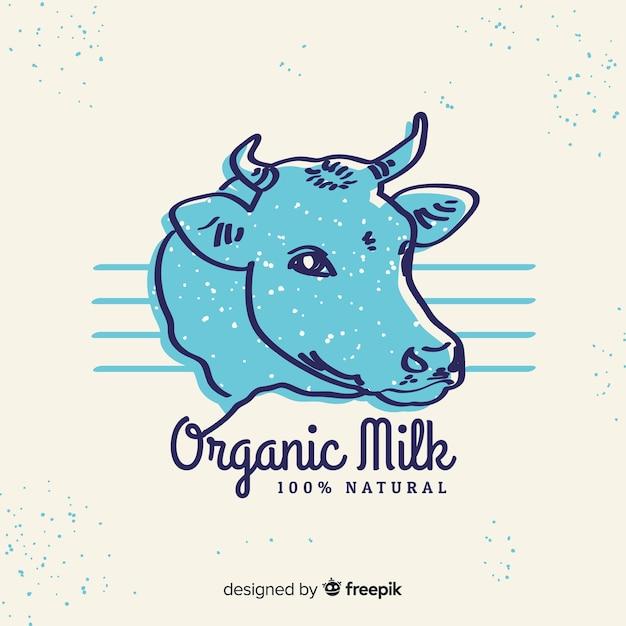 Mão desenhada logotipo de leite de cabeça de vaca Vetor grátis