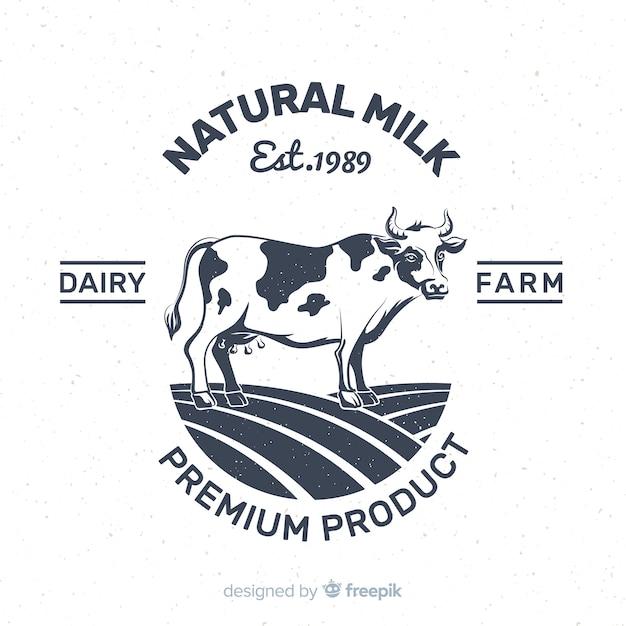 Mão desenhada logotipo de leite de vaca Vetor grátis