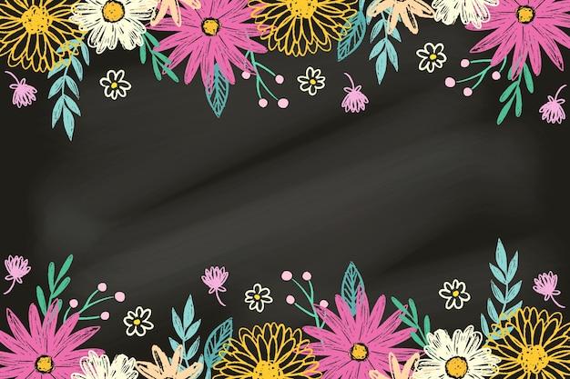 Mão desenhadas flores sobre fundo de quadro-negro Vetor grátis