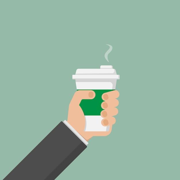 Mão do empresário segurando xícara de café quente Vetor Premium