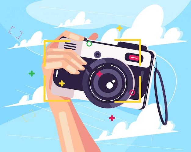 Mão e câmera Vetor Premium