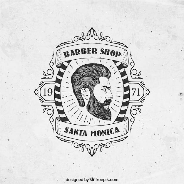 Mão emblema barbearia desenhada Vetor grátis
