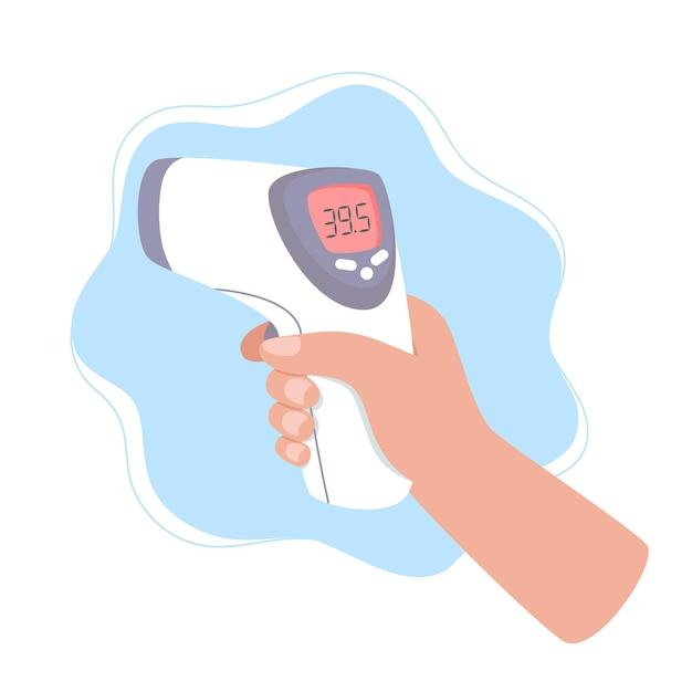 Mão segura um termômetro infravermelho para medir a temperatura corporal Vetor Premium