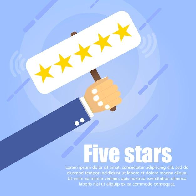 Mão segura uma mesa com cinco estrelas douradas Vetor Premium