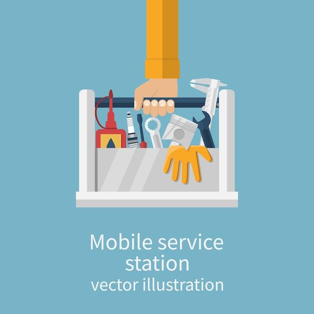 Mão segurando a caixa de ferramentas Vetor Premium