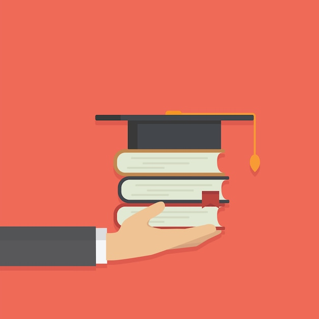 Mão segurando a pilha de livro com chapéu de graduados Vetor Premium