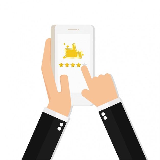 Mão segurando e apontando para um smartphone com 5 estrelas Vetor Premium