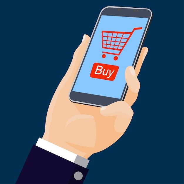 Mão segurando móvel com compras on-line Vetor Premium