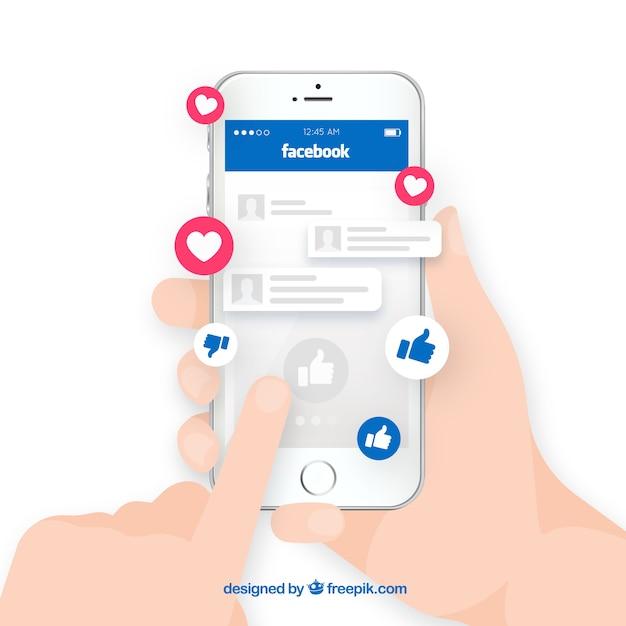 Mão segurando o telefone com notificações do facebook Vetor grátis