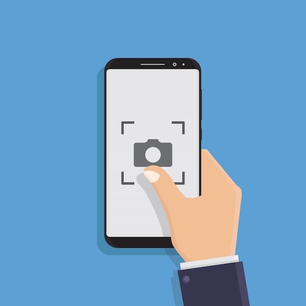 Mão segurando o telefone inteligente, tirar fotos, ilustração Vetor Premium