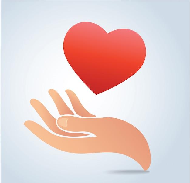 Mão segurando o vetor de coração Vetor Premium