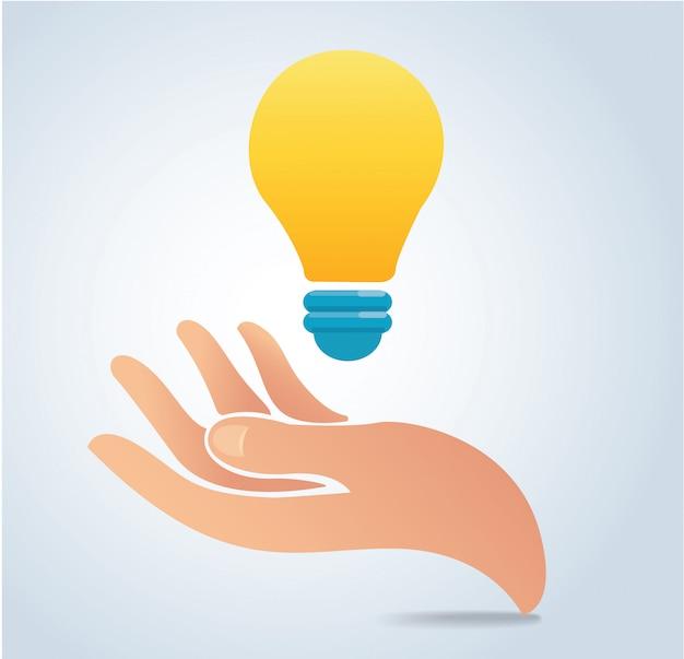 Mão segurando o vetor de lâmpada Vetor Premium