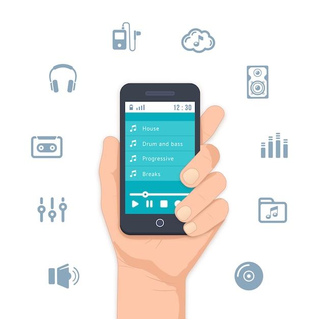 Mão segurando um mp3 player móvel com uma lista de músicas na tela e rodeado por uma variedade de músicas e entretenimento Vetor grátis