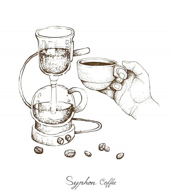Mão segurando um tiro de café com cafeteira de sifão Vetor Premium