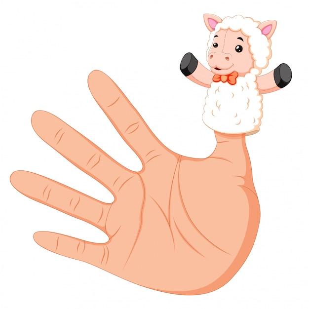Mão usando um fantoche de dedo de ovelha branca no polegar Vetor Premium