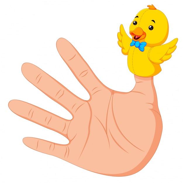 Mão usando um fantoche de dedo de pato no polegar Vetor Premium