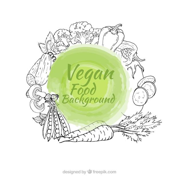 Mão vegan fundo desenhado alimentos Vetor grátis