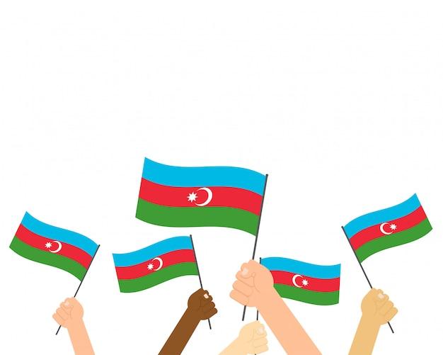 Mãos de ilustração vetorial segurando bandeiras do azerbaijão Vetor Premium