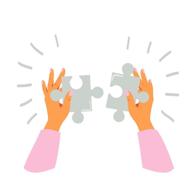 Mãos femininas detém e dobras de peças de quebra-cabeça Vetor Premium