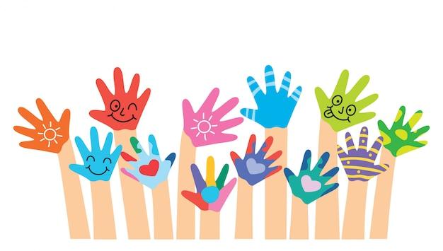 Mãos pintadas de crianças pequenas Vetor Premium