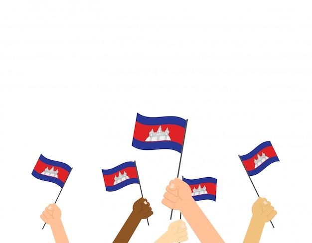 Mãos, segurando, cambodia, bandeiras Vetor Premium