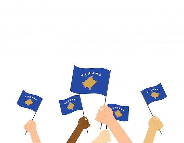 Mãos, segurando, kosovo, bandeiras Vetor Premium