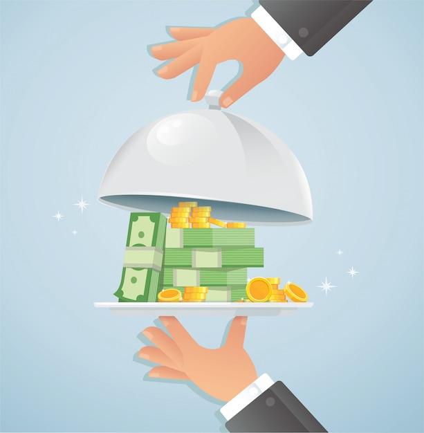 Mãos segurando prata cloche com dinheiro Vetor Premium