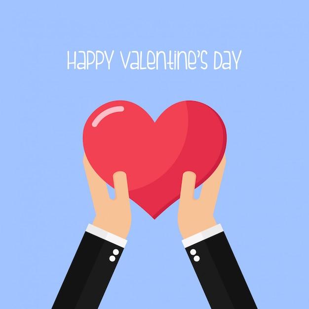 Mãos segurar coração forma amor dia dos namorados cartão de saudação Vetor Premium