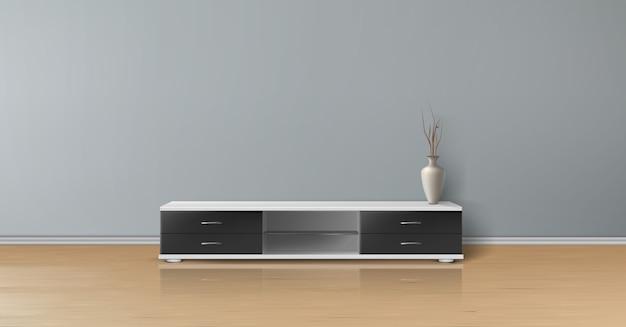 Maquete realista de sala vazia com parede plana cinza, piso de madeira, suporte de tv com gavetas pretas Vetor grátis