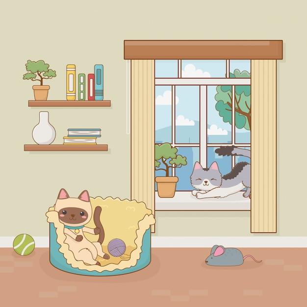 Mascote de gatos pouco na sala de casa Vetor Premium