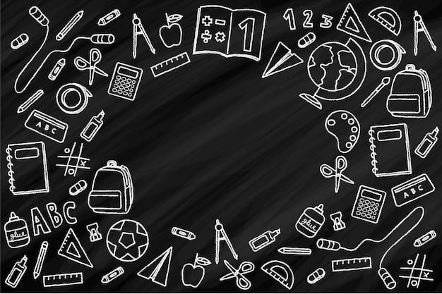 Material escolar no quadro-negro Vetor grátis