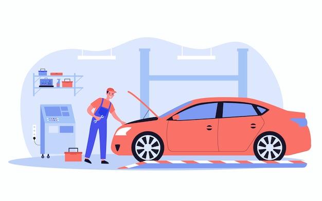 Mecânico consertando carro na garagem Vetor Premium