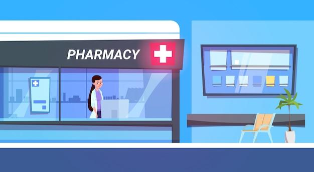 Médico feminino, em, loja farmácia, em, modernos, hospitalar, farmácia, loja Vetor Premium