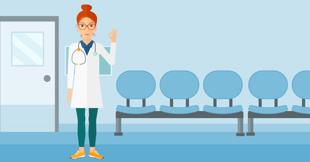 Médico mostrando sinal ok. Vetor Premium